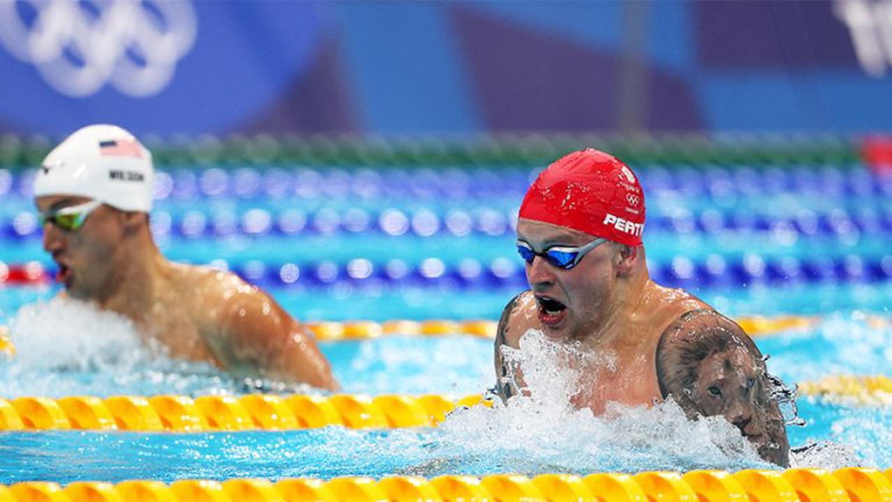 Britain wins wild Olympic debut of 4×100 mixed medley, where men, women swim together and it's hard to tell who's ahead