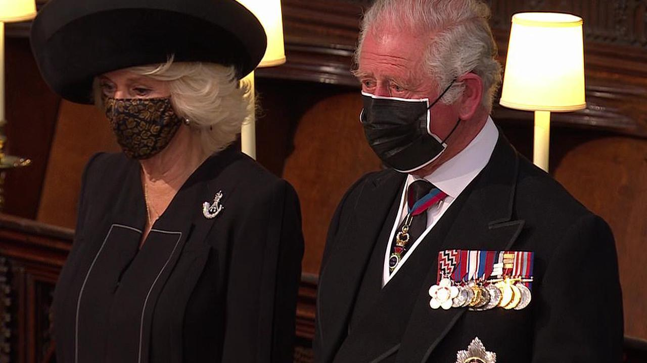 Duchess of Cornwall pays tribute to Prince Philip with a diamond brooch from his former regiment as she supports Prince Charles at St George's Chapel