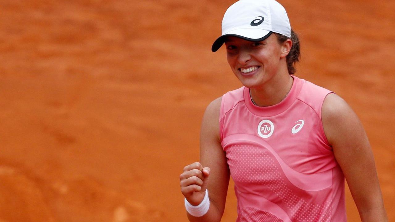 The Latest: Mattek-Sands, Swiatek reach FO doubles final