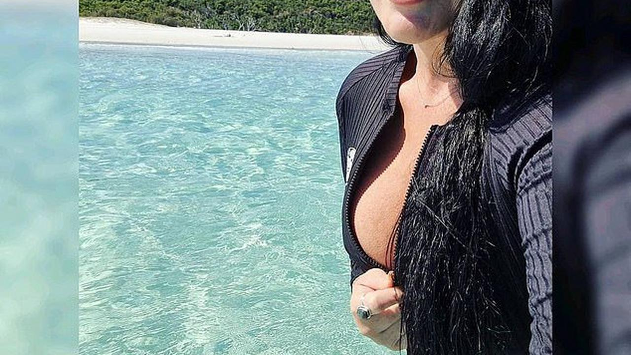 Schapelle Corby flaunts sideboob in a partially unzipped swim top as she enjoys a Queensland getaway with her mother Rosleigh Rose