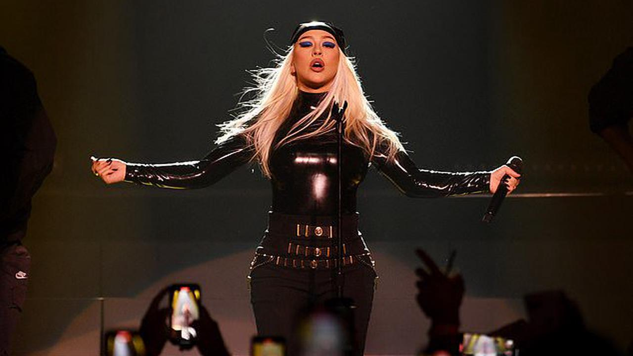 Christina Aguilera flaunts her sensational figure in black latex as she turns rock chick for jaw-dropping Las Vegas performance