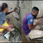 How Many Nigerian Lady Can Do This? See The Picture Of A Lady Helping Her Boyfriend To Do His Work