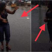 Checkout What A Patriotic Lady Did In Traffic, While In The Rain, That Made People React (Photos)