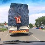 Man hangs on the back of a truck from Jozi to Durban.[FICTION]