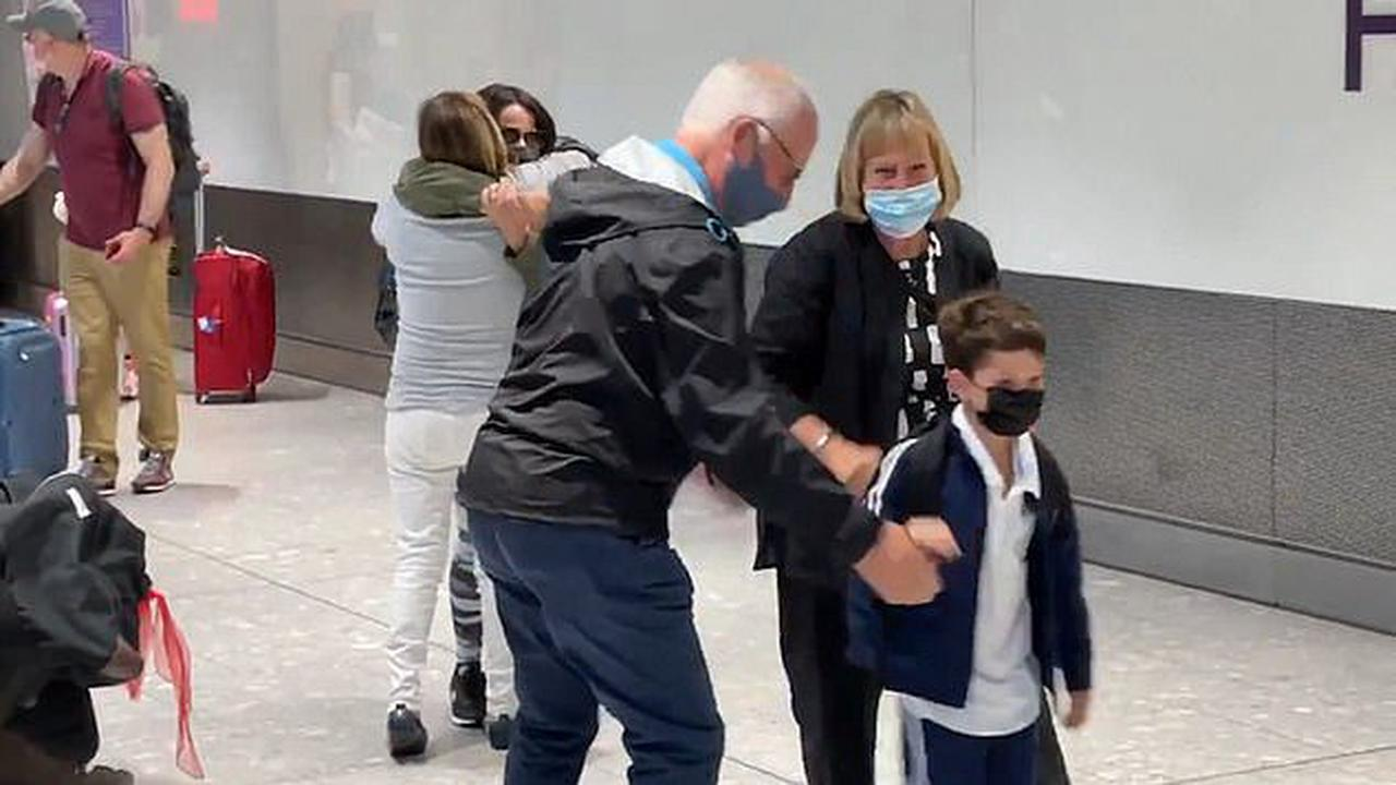 Delighted grandparents meet grandchildren for first time at Heathrow as double-jabbed visitors are allowed into UK from US and EU without quarantining