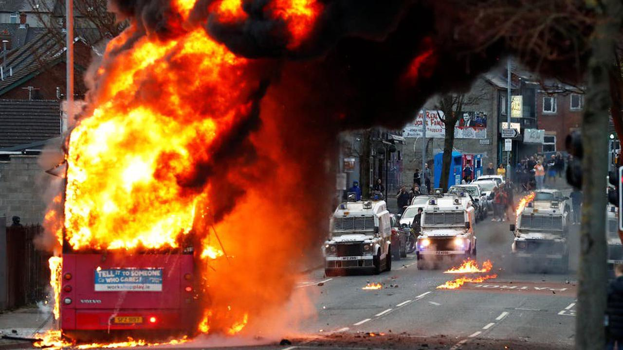 Bus explodes after being pelted with petrol bombs as violence in Northern Ireland continues