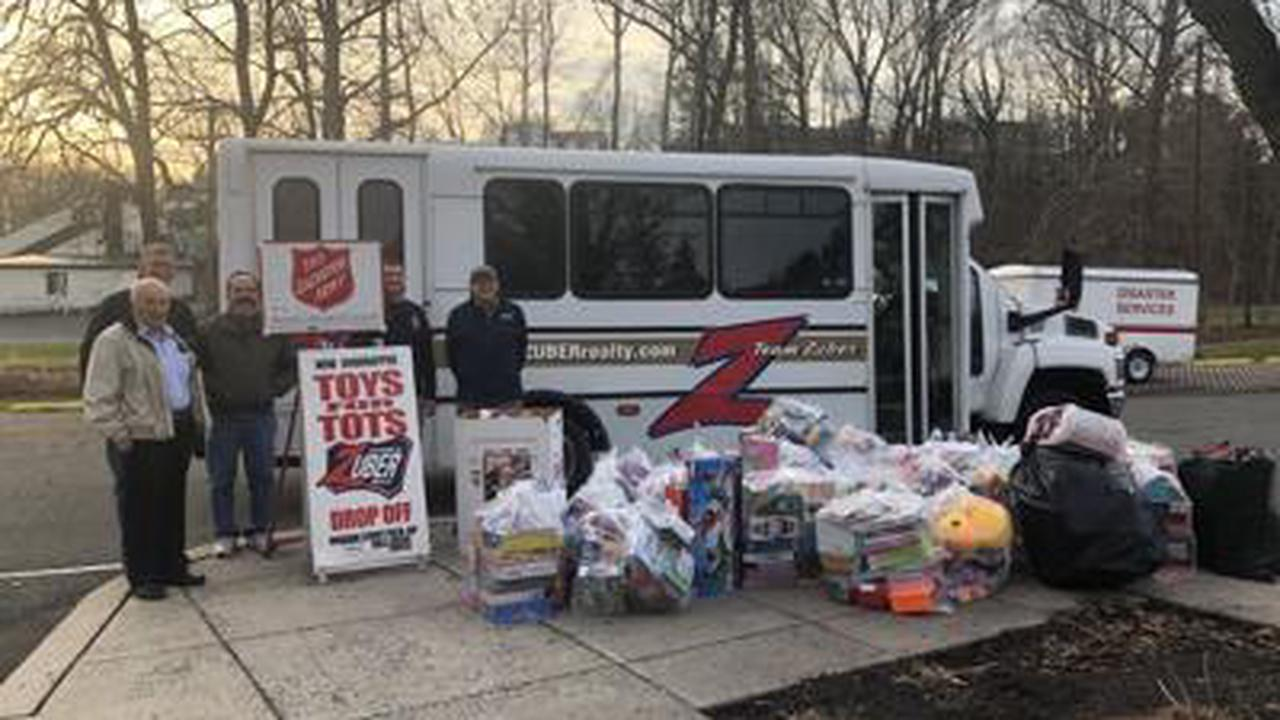 Real estate agency donates to annual Toys for Tots effort