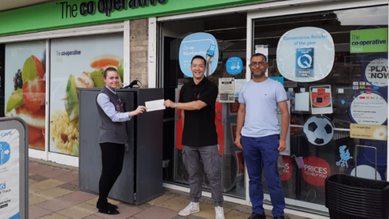 Co-Op shows support for the Phoenix Resource Centre with £200 cheque