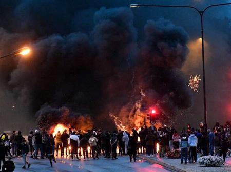 Far right activists burn Qur'an.