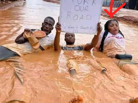 Checkout Reactions On Facebook As A Lady Is Spotted Sitting In Dirty Water To Protest In Owerri.