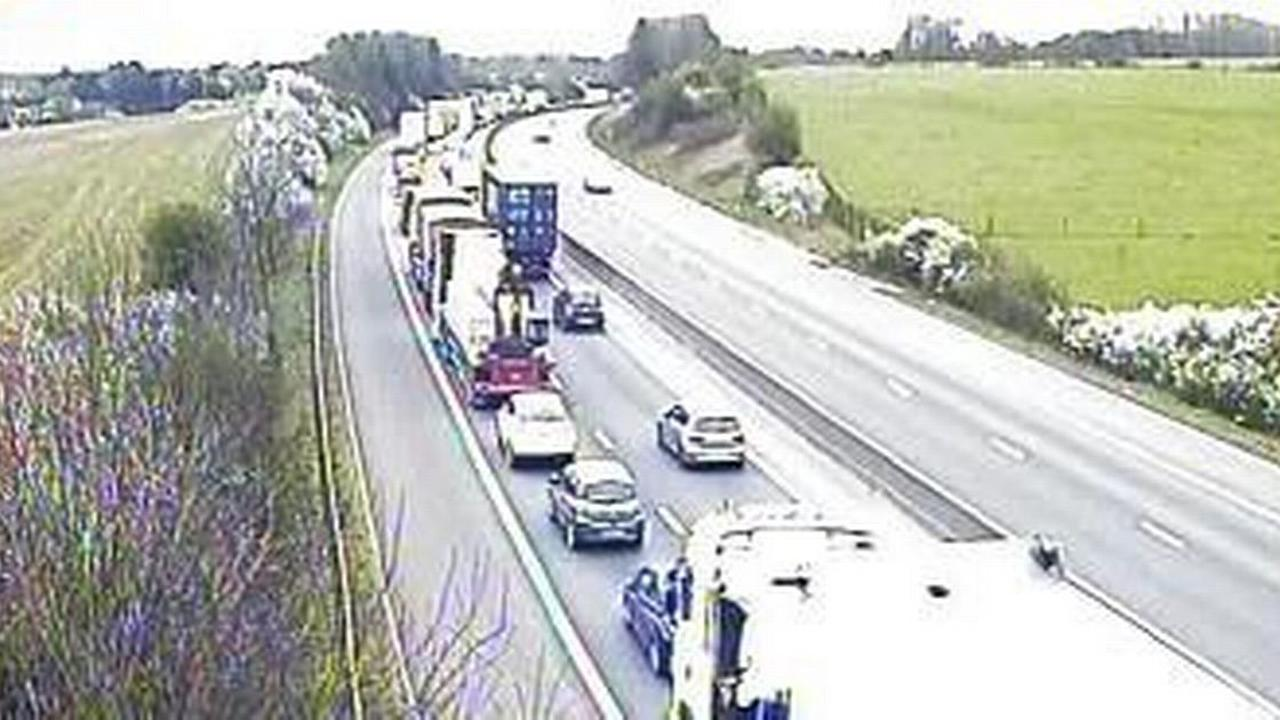 Live: M11 completely shut after 'lorry strikes bridge'