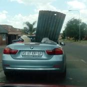 A Man Carrying Corrugated Iron Sheets On A BMW Convertible Has Caused A Stir On Social Media.