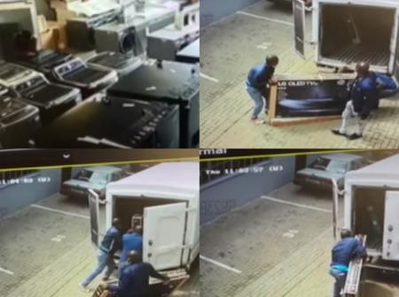 Watch : Criminals Hold Up A Business Premises At Gun Point & Steal Smart Tv's.