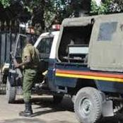Police officer tears the BBI report in Bomet