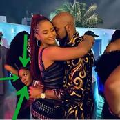 While Adesua and Banky W were loved up, see what a lady was doing behind them