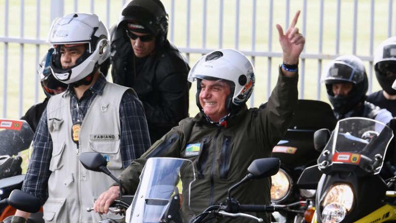 Feeling the pressure, Brazil's Bolsonaro rallies his troops