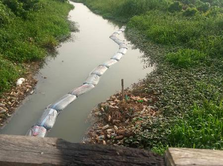 PHOTOS: How 30 sacks full of stolen petrol were found floating on canal after pipeline vandals fled