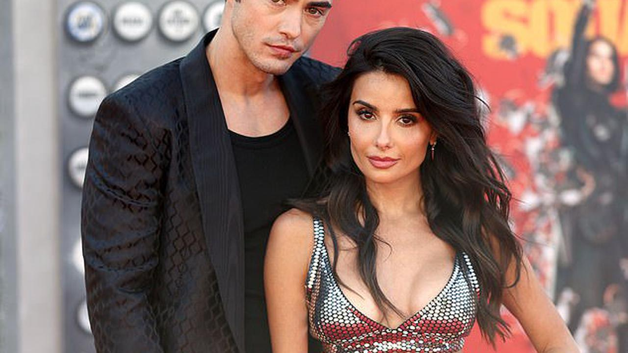 Darren Barnet and girlfriend Mikaela Hoover pack on the PDA as they make steamy red carpet debut as a couple at The Suicide Squad premiere