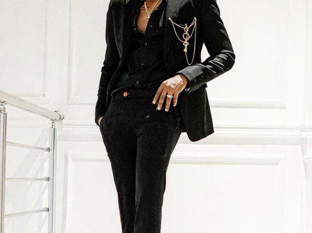 See recent pictures of Kizz Daniel, He looks hot in black dresses.