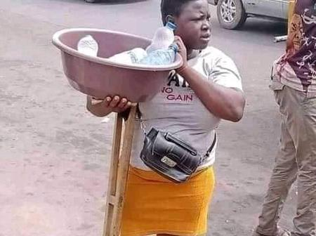 Check Out Photos of a Disabled Girl selling pure water on the street.