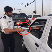 Photos Of Dubai Police Men Sharing Food To Drivers Causes Stirs Online