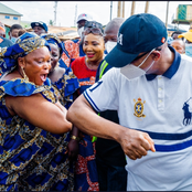 Governor Greets a woman with elbow bump during his weekend inspection of road reconstruction