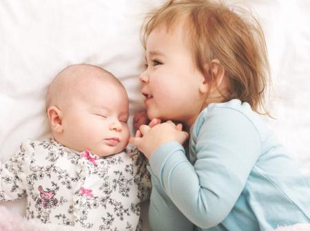 8 tips to help your child adjust to a new sibling.