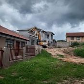 A business man called in an Excavator and TLB to demolish a house he built for his girlfriend