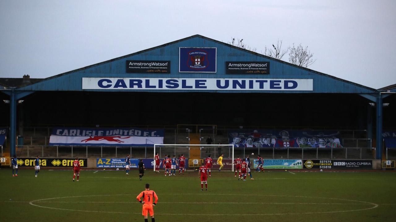 Chris Beech reacts as Jon Mellish signs new deal at Carlisle United