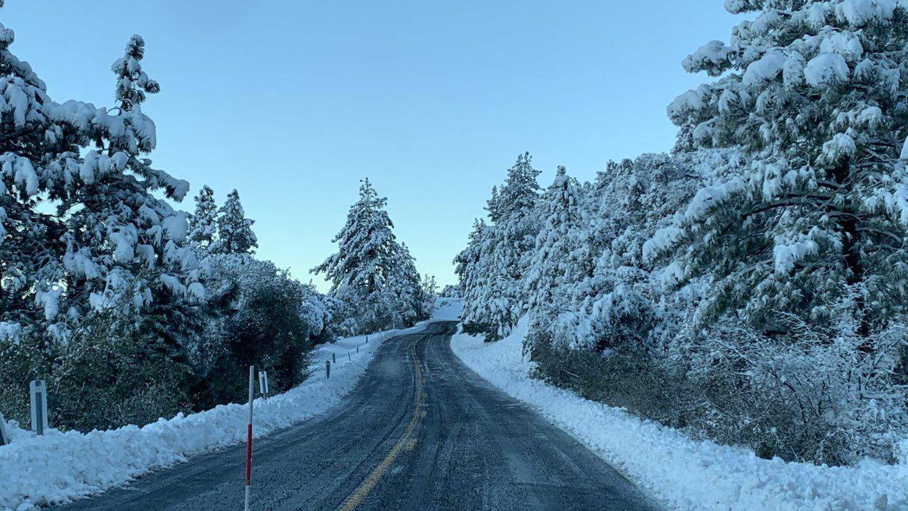 Southern California mountains coated in snow after storm