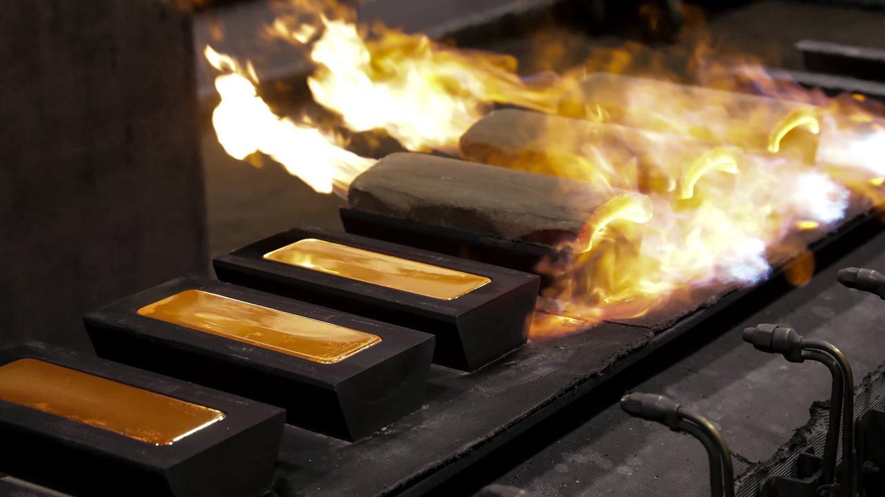 Gold dips as firmer U.S. dollar offsets easing bond yields