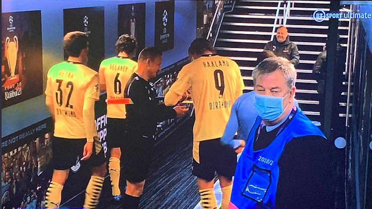 UEFA warn match officials that asking players for autographs is 'unacceptable and undignified' after Dortmund striker Erling Haaland was caught on camera signing red and yellow cards for linesman