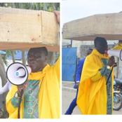 Mixed Reaction As Nigerian Pastor Was Spotted Carrying A Coffin On His Head On The Street Of Lagos.