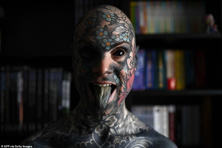 French primary school teacher who spent ?35k covering his body in tattoos is banned from kindergarten because he gives children nightmares (photos)