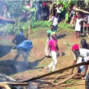 Chaotic Scenes As Mourners Turn On The Deceased Burning His Corpse Before Filling Grave With Stones