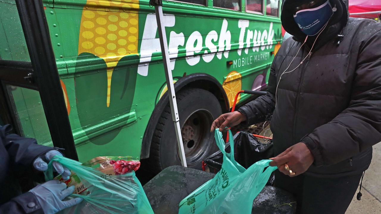 Trucks bring fresh food to the people who need it