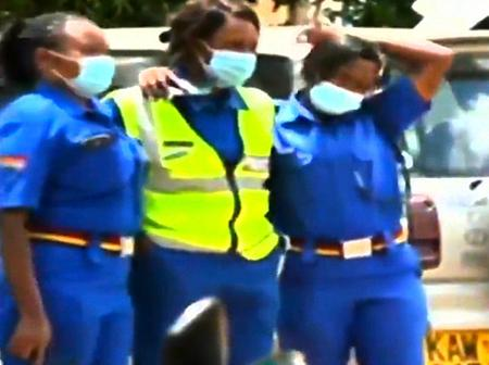 Touching Photos Of Female Officers Who Went To See Matiangi's Bodyguard Wife's Body