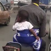 A Man On Bike Backing His Child (Video)