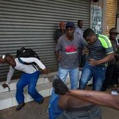 Video Of Zimbabweans Chasing and Beating South Africans At Hillbrow While The Lady From Zim Laughing