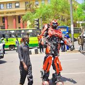 Nairobi Rich Market Analyst Babu Stephen And His Robot celebrate women's Day By Giving Out Flowers