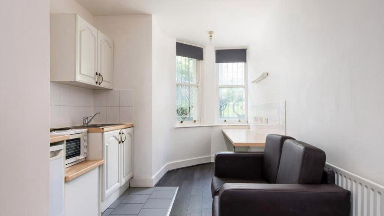 Flat so small the bed is suspended over sofa in kitchen on market for £140,000