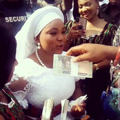 Photos Of Zubby Michael Spraying Money On Rachel Okonkwo At Her Mother's Burial Ceremony