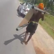 'Village People at Work' - As others were packing food palliatives, See what this man was seen with.