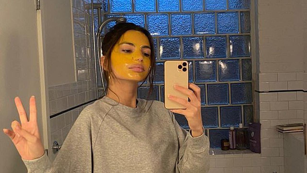 Emily Ratajkowski shows off her AMAZINGLY taut midriff in mud mask bathroom selfie... just TWO MONTHS after giving birth to son Sylvester
