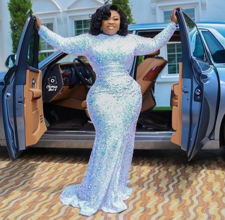 d3698bc2f3783a9fa46d28f3102e168c?quality=uhq&resize=720 - Rev Obofour's Wife Flaunts Her Curvaceous Body & Rolls Royce As Her Celebrates Her 33rd Birthday