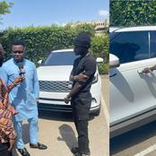 Kuami Eugene becomes dumbfounded as Dr Oteng of Adonko gifts him a brand new model of a Range Rover.