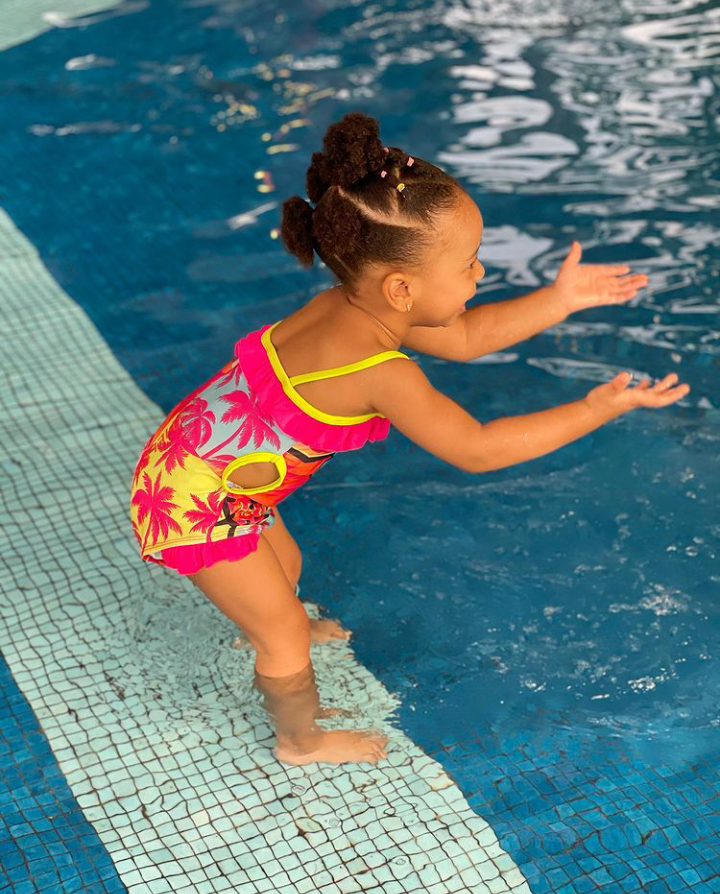 BBNaija star, TBoss releases adorable new photos of her daughter playing in the swimming pool 17
