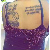 Lady tattooed politician face, name on her back. Will she be rewarded for this?