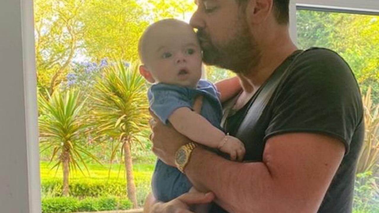 Doting grandad Danny Dyer sweetly kisses daughter Dani's baby son Santiago