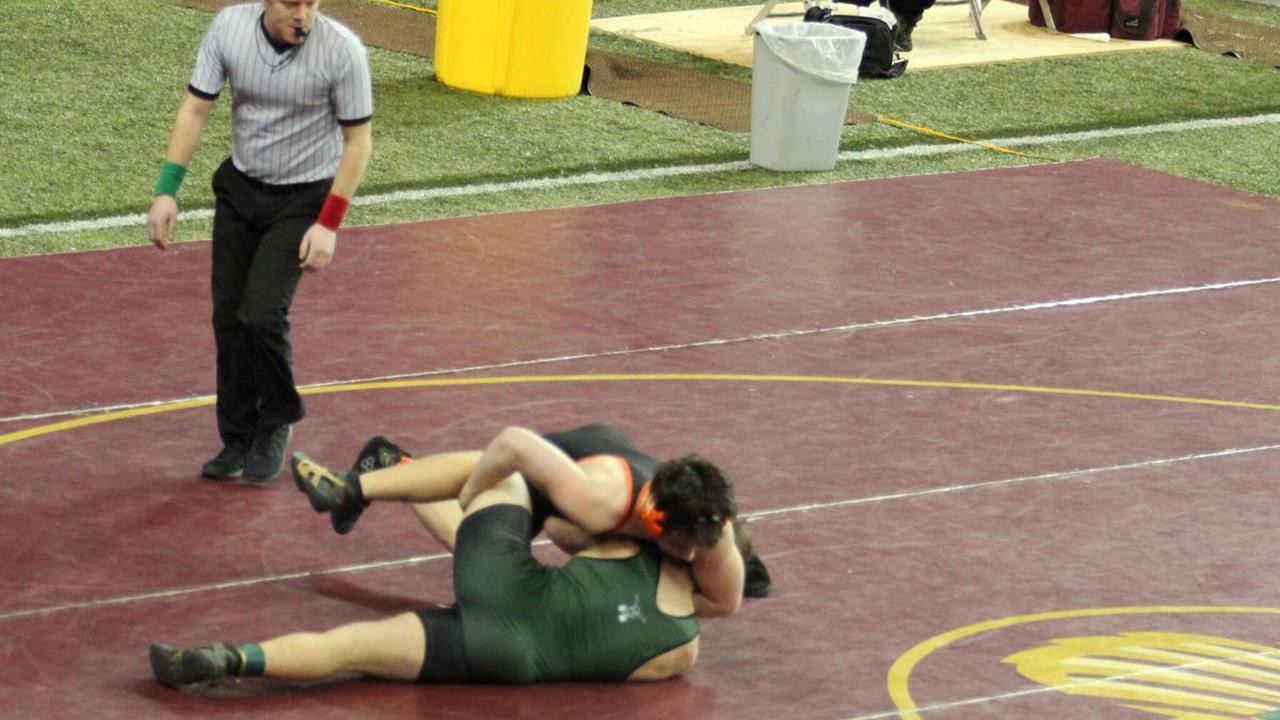 Midland wrestlers take first loss of season